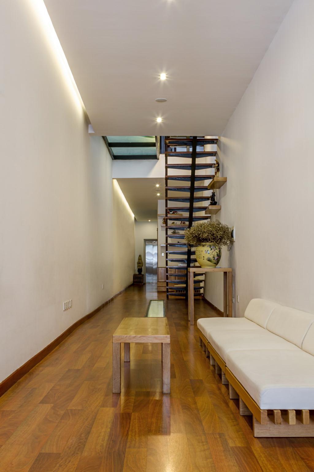 Tầng 1 được cho thuê, gia đình sinh hoạt ở những tầng trên. Ảnh © Hoàng Lê