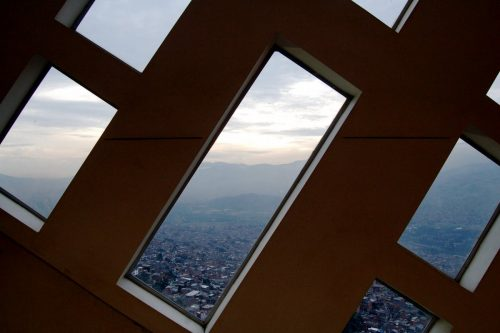 from-inside-the-library-in-the-santo-domingo-savio-neighborhood-the-view-is-of-medelln-itself-in-a-valley-surrounded-by-the-andes
